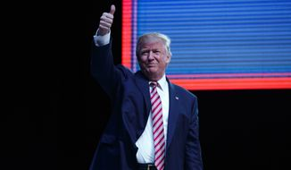 Republican presidential candidate Donald Trump arrives to speak during a campaign rally, Tuesday, Oct. 11, 2016, in Panama City, Fla. (AP Photo/ Evan Vucci)