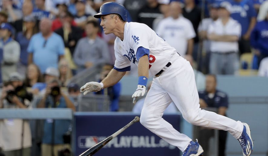 Los Angeles Dodgers' Chase Utley watches his RBI-single during the eighth inning in Game 4 of a baseball National League Division Series against the Washington Nationals in Los Angeles, Tuesday, Oct. 11, 2016. (AP Photo/Jae C. Hong)