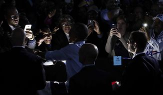 President Barack Obama greets people in the audience after speaking at a campaign event for Democratic presidential candidate Hillary Clinton at the White Oak Amphitheatre in Greensboro, N.C., Tuesday, Oct. 11, 2016. (AP Photo/Carolyn Kaster)