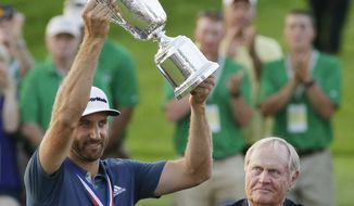 FILE - In this June 19, 2016, file photo, Dustin Johnson holds the trophy as Jack Nicklaus looks on after winning the U.S. Open golf championship at Oakmont Country Club, in Oakmont, Pa. Johnson made it a clean sweep of the tour's biggest honors that are named after its most prominent players. He won the Jack Nicklaus Award as player of the year, the Arnold Palmer Award for leading the money list and the Byron Nelson Award for having the lowest adjusted scoring average. (AP Photo/Gene J. Puskar, File)