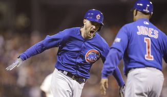 Chicago Cubs' Kris Bryant, left, celebrates with third base coach Gary Jones (1) after hitting a two-run home run against the San Francisco Giants during the ninth inning of Game 3 of baseball's National League Division Series in San Francisco, Monday, Oct. 10, 2016. (AP Photo/Ben Margot)