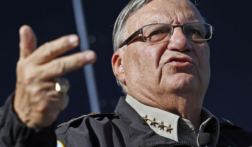 In this Jan. 9, 2013, file photo, Maricopa County Sheriff Joe Arpaio speaks to reporters in Phoenix, Ariz. A judge will hold a hearing in Phoenix, Ariz., Tuesday, Oct. 11, 2016, to discuss legal issues raised by a recommendation that prosecutors file a criminal contempt-of-court case against Arpaio. The hearing falls the day before early voting starts in Arpaio's bid for a seventh term as metro Phoenix's top law enforcer. (AP Photo/Ross D. Franklin, File)