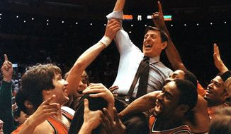 FILE - In this March 12, 1983, file photo, St. John's coach Lou Carnesecca is carried by his team after the Redman beat Boston College 85-77 in the Big East Championship at New York's Madison Square Garden. Once the stories started being told it was hard to stop. The memories of the Big East Conference and Madison Square Garden for the past 34 years were the topic of a panel discussion Tuesday to celebrate the great relationship between conference and building. (AP Photo/G. Paul Burnett, File)