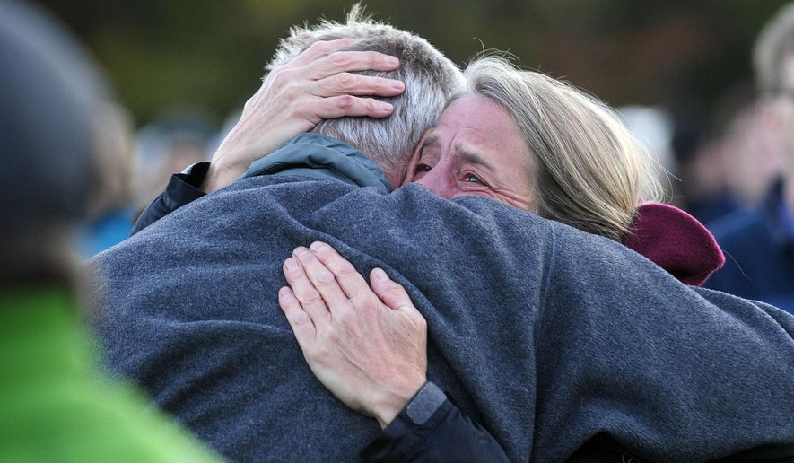 Mourners share a tearful embrace Monday, Oct. 10, 2016, during a vigil attended by about 1,000 at Harwood Union High School in Duxbury, Vt., held for the teenaged victims killed in Saturday night's crash on Interstate 89 in Williston. Four of the five teens killed by the wrong-way driver were students at Harwood. The fifth student killed was from Fayston and attended a private school in New Hampshire. (Stefan Hard/Times Argus via AP)