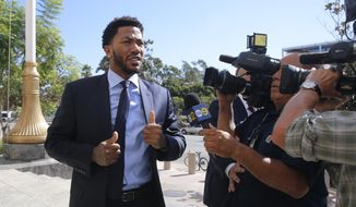 FILE - In this Thursday, Oct. 6, 2016, file photo, New York Knicks basketball player Derrick Rose arrives at U.S. District Court in downtown Los Angeles. NBA star Rose is set to return to the witness stand in a $21 million lawsuit that alleges he and two friends raped an incapacitated woman. Before Rose retakes the stand Tuesday, Oct. 11, a judge will consider a mistrial request from Rose's lawyer. (AP Photo/Damian Dovarganes, File) **FILE**