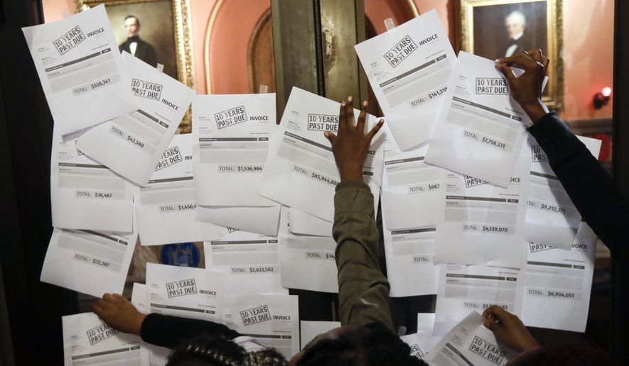 Advocates post education invoices on the doors to Gov. Andrew Cuomo's office at the state Capitol on Tuesday, Oct. 11, 2016, in Albany, N.Y. More than a week after setting out on foot from New York City, a group of students, parents and education advocates arrived in Albany in pursuit of more school funding. Organizers say the walk was meant to draw attention to the billions of dollars the state owes students in the wake of the 2006 Campaign for Fiscal Equity case that found New York was underfunding schools. (AP Photo/Mike Groll)