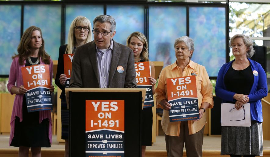 In this photo taken Sept. 21, 2016, Daniel Weiner, center, Senior Rabbi at Temple De Hirsch Sinai in Bellevue, Wash., speaks at news conference in Bellevue promoting Initiative 1491, which will be on the ballot in the November elections. If passed by voters, the initiative would allow law enforcement or others to obtain court orders to temporarily take guns from people considered a danger to themselves or others. Weiner is a founding member of the Washington Alliance for Gun Responsibility. (AP Photo/Ted S. Warren)