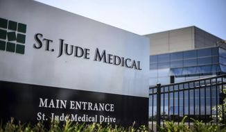 FILE - This Wednesday, July 22, 2015, file photo shows St. Jude Medical corporate headquarters, in Little Canada, Minn., just north of St. Paul. Medical device maker St. Jude Medical is warning doctors and patients about a rare battery defect in some of its implantable heart devices that can cause them to fail much earlier than expected. The company said Tuesday, Oct. 11, 2016, the batteries should be replaced immediately after patients receive an electronic, vibrating alert from the device. Normally patients have up to three months to have batteries replaced. But the company said a small subset of its heart-shocking defibrillators can fail within 24 hours of the alert. (Glen Stubbe/Star Tribune via AP, File)