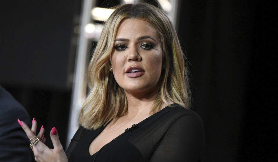 "FILE - In this Jan. 6, 2016, file photo, Khloe Kardashian participates in the panel for ""Kocktails with Khloe"" at the FYI 2016 Winter TCA in Pasadena, Calif. Kardashian said on the ""Ellen DeGeneres Show"" in an interview broadcast on Tue., Oct. 11, 2016, that her older sister, Kim Kardashian West, is ""not doing that well"" more than a week after being held up during a Paris jewelry heist. (Photo by Richard Shotwell/Invision/AP, File)"