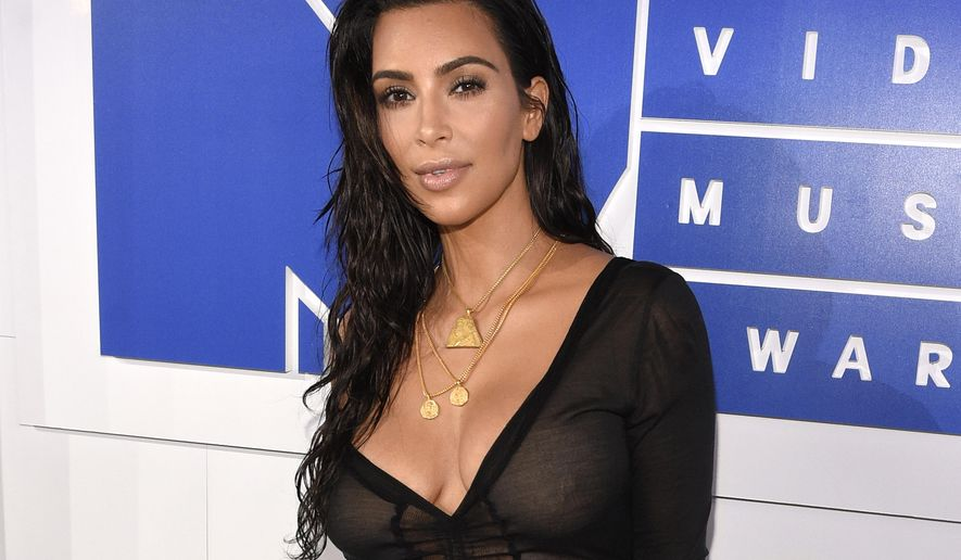 FILE - In this Aug. 28, 2016 file photo, Kim Kardashian West arrives at the MTV Video Music Awards in New York. Kardashian West is suing online media outlet, MediaTakeOut.com, saying she was wrongly portrayed as a liar and thief after she was attacked in Paris. Police say armed robbers forced their way into a private residence where Kardashian West was staying on Oct. 3, tied her up and stole $10 million worth of jewelry. (Photo by Chris Pizzello/Invision/AP, File)