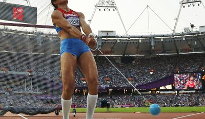 FILE- In this Friday, Aug. 10, 2012 file photo, Russia's Tatyana Lysenko competes in the women's hammer throw final during the athletics in the Olympic Stadium at the 2012 Summer Olympics, London. Lysenko has been stripped of her gold medal from the 2012 London Olympics after testing positive in reanalysis of her stored doping samples, it was reported on Tuesday, Oct. 11, 2016. (AP Photo/Matt Dunham, File)