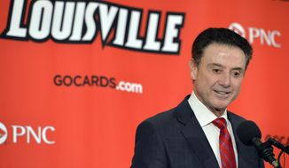 Louisville head basketball coach Rick Pitino answers questions during the team's annual NCAA college basketball media day, Tuesday, Oct. 11, 2016, in Louisville Ky. (AP Photo/Timothy D. Easley)
