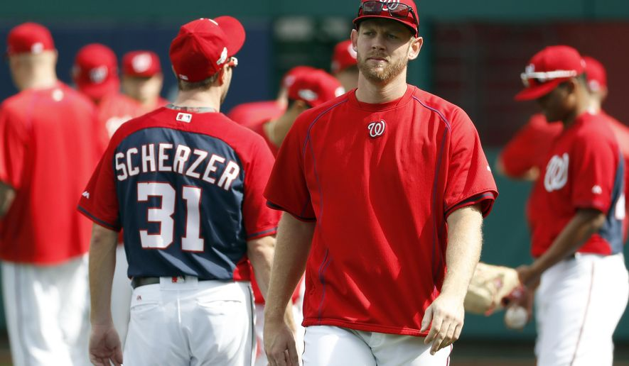 FILE - In this Tuesday, Oct. 4, 2016, file photo, Washington Nationals starting pitcher Stephen Strasburg walk on the field during baseball batting practice at Nationals Park, in Washington. Strasburg's bullpen session at Dodger Stadium was cut short after the Nationals pitcher experienced discomfort in his right elbow.  Manager Dusty Baker said Tuesday, Oct. 11, 2016, that Strasburg threw 30 or 31 pitches instead of the scheduled 35 in Monday's session. (AP Photo/Alex Brandon, File)