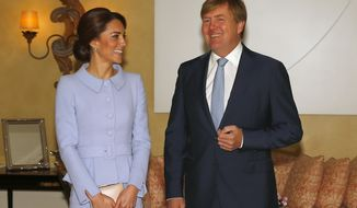 Britain's Kate, the Duchess of Cambridge, and Dutch King Willem-Alexander pose for photographers upon the Duchess' arrival in The Hague, Netherlands, Tuesday, Oct. 11, 2016. (AP Photo/Peter Dejong)