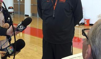 Oregon State head coach Wayne Tinkle talks to reporters following NCAA college basketball practice in Corvallis, Ore., Tuesday, Oct. 11, 2016.  Oregon State is preparing for the upcoming season with hopes of building on last season's return to the NCAA Tournament after a 26-year absence. (AP Photo/Anne Peterson)