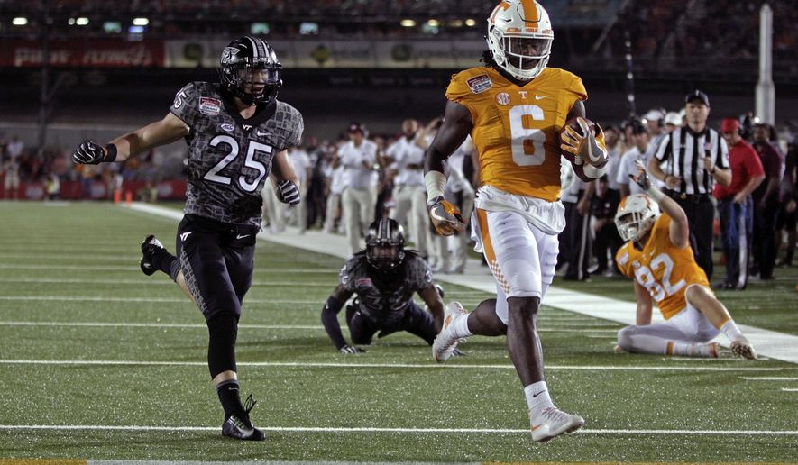 FILE - In this Sept. 10, 2016, file photo, Tennessee running back Alvin Kamara (6) scores a touchdown against Virginia Tech in an NCAA college football game at Bristol Motor Speedway in Bristol, Tenn. Kamara will face his former team Saturday when the ninth-ranked Volunteers host No. 1 Alabama. (AP Photo/Wade Payne, File)