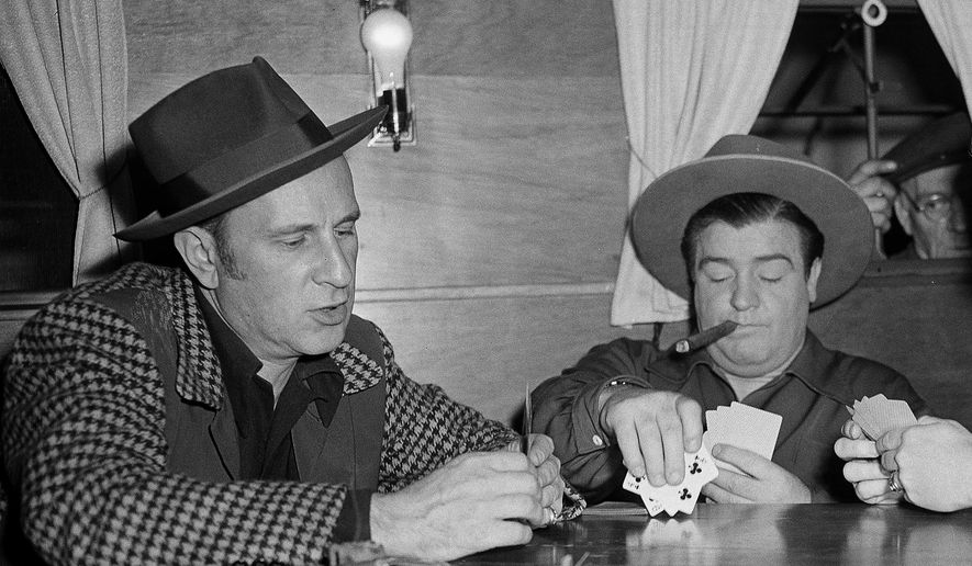 "FILE - In this March 2, 1945, file photo, Abbott, left, and Costello play cards on set in Los Angeles. Producers of a now-closed Broadway play can use Abbott and Costello's famous ""Who's on First"" routine over objections by the comedy duo's heirs, an appeals court ruled Tuesday, Oct. 11, 2016. (AP Photo, File)"