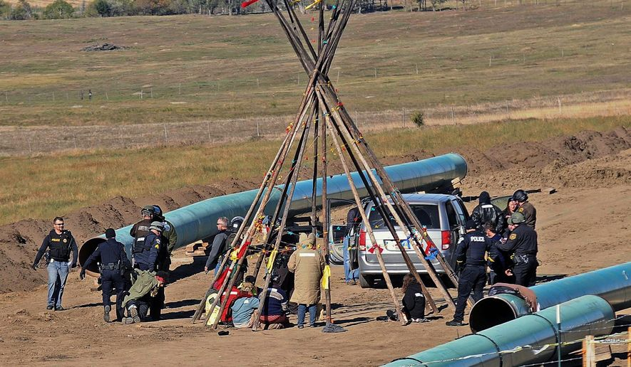 Law enforcement officers have clashed with protesters trying to stop the Dakota Access Pipeline in North Dakota. An extreme faction within the protest encampment has been terrorizing the rural community. (Associated Press)