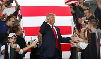 Republican presidential candidate Donald Trump gestures as he arrives to speak at a campaign rally, Wednesday, Oct. 12, 2016, in Ocala, Fla. (AP Photo/ Evan Vucci)