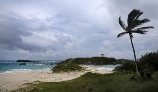 Wind and surf picks up as Hurricane Nicole approaches the Coopers Island Nature Reserve in St. Georges, Bermuda, Wednesday, Oct. 12, 2016. Wind and rain began battering Bermuda as the British territory braced itself for Hurricane Nicole, which could become a major Category 3 storm before it hits the island on Thursday morning. (AP Photo/Mark Tatem)