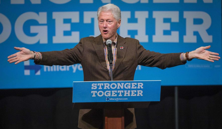 Former President Bill Clinton holds an early voting event on Simpson College's campus in Indianola, Iowa, Wednesday Oct. 12, 2016, working to convince Iowans to vote for Hillary Clinton.  (Rodney White/The Des Moines Register via AP)