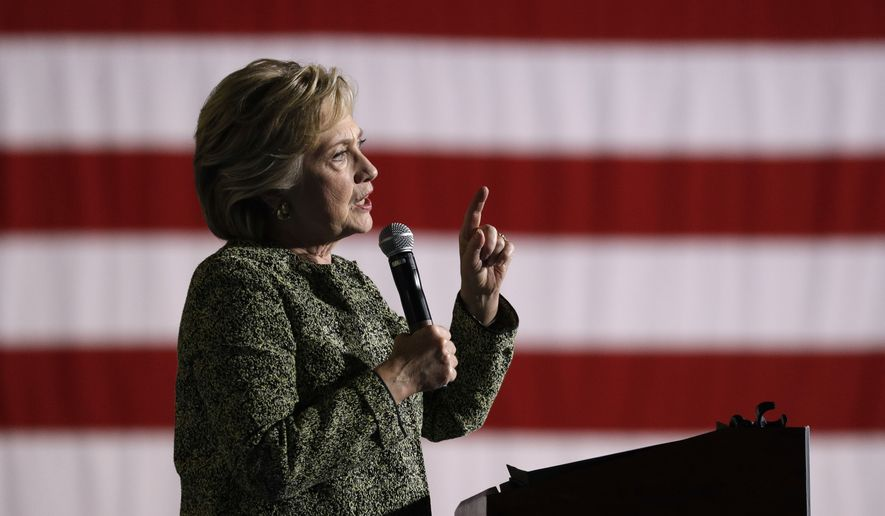 Democratic presidential candidate Hillary Clinton speaks at a rally, Wednesday, Oct. 12, 2016, in Las Vegas. (AP Photo/John Locher)
