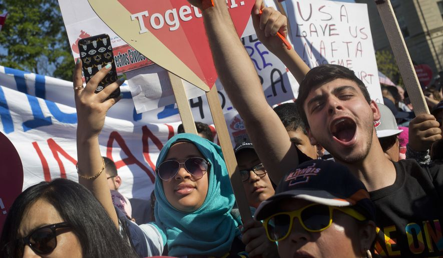 Supporters of immigration reform gather in front the Supreme Court in Washington on April 18. (Associated Press)