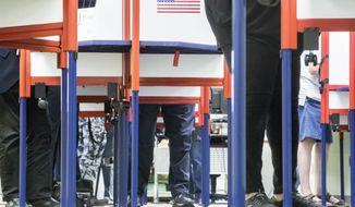 Voters fill out their ballots at the Hamilton County Board of Elections as early voting begins statewide, Wednesday, Oct. 12, 2016, in Cincinnati. (AP Photo/John Minchillo)