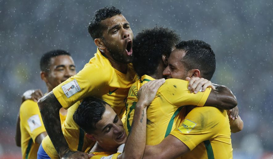 Brazil's players celebrate after teammate Willian scored a second goal against Venezuela during a 2018 World Cup qualifying soccer match in Merida, Venezuela, Tuesday, Oct. 11, 2016.  (AP Photo/Ariana Cubillos)