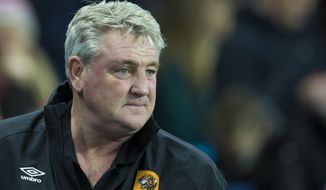 FILE - A Tuesday, Dec. 1, 2015 photo from files of Hull City's manager Steve Bruce on the touchline before his team's English League Cup soccer match between Manchester City and Hull City at the Etihad Stadium, Manchester, England. Second-tier club Aston Villa has hired Steve Bruce as its fourth manager in the past year, turning to a coach with proven ability to get team promoted back to the Premier League. Villa, the European champion in 1982, is languishing in 19th place in the 24-team League Championship as it struggles to adapt to life out of the Premier League following relegation last season.  (AP Photo/Jon Super, File)