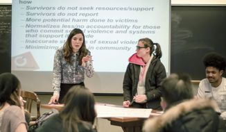 """In this April 8, 2016, photo provided by Breakthrough, Columbia University graduate student Savannah Badalich leads a Breakthrough Campus Catalyst Training with student activists at Syracuse University in Syracuse, N.Y., for Sexual Assault Awareness Month. When news broke that Donald Trump, the Republican nominee for president, had bragged of groping women, and then trivialized it as """"locker room talk,"""" it felt to some students like a repudiation of their efforts. (Jacob Greenfield/Breakthrough via AP)"""