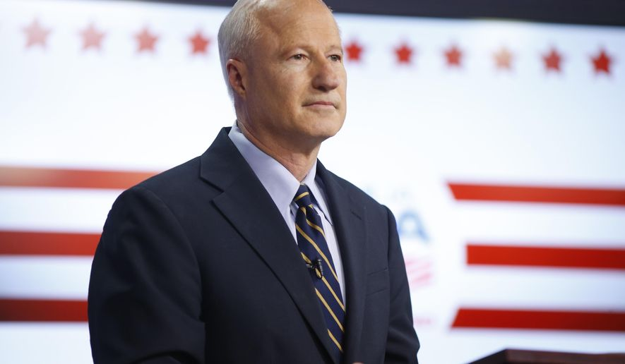 In this Tuesday, Oct. 4, 2016, photograph, U.S. Congressman Mike Coffman, R-Colo., waits to take part in a televised debate with his opponent for Colorado's 6th Congressional District, Democrat Morgan Carroll, at a Spanish language television station in Denver. (AP Photo/David Zalubowski)