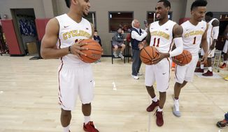 Iowa State guard Naz Mitrou-Long, left, laughs with teammate Monte Morris (11) during NCAA college basketball media day, Wednesday, Oct. 12, 2016, in Ames, Iowa. (AP Photo/Charlie Neibergall)