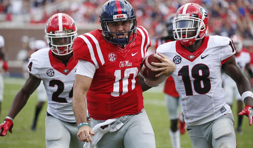 FILE - In this Sept. 24, 2016, file photo, Mississippi quarterback Chad Kelly (10) runs past Georgia cornerback Deandre Baker (18) and safety Dominick Sanders (24) for a 41-yard touchdown run during the second half of an NCAA college football game in Oxford, Miss. The Southeastern Conference, which already made history by winning seven consecutive national championships (2006-12) and eight in the last 10 years, could have a record number of first-round picks in the 2017 NFL draft. (AP Photo/Rogelio V. Solis, File)