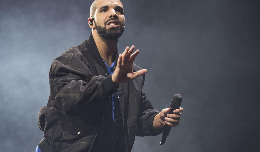 FILE - In this Oct. 8, 2016 file photo, Drake performs on stage in Toronto, Canada. Drake is the leading nominee with 12 nominations at the Soul Train Awards. The show will air on BET and Centric on Nov. 27.(Photo by Arthur Mola/Invision/AP, File)