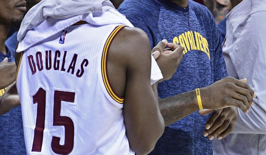 FILE- In this Oct. 8, 2016. file photo, Cleveland Cavaliers forward LeBron James (23) laughs with guard Toney Douglas (15) during the second half of an NBA preseason basketball game in Cleveland. NBA Commissioner Adam Silver and James are openly expressing their optimism for the NBA and its players being able to strike a new labor deal in the coming weeks. Either side can opt out of the current deal in December, and the sides are working to get something done before then.(AP Photo/David Dermer, File)