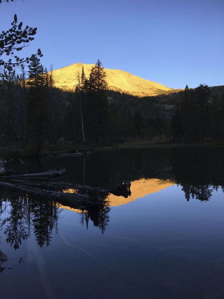 ADVANCE FOR THE WEEKEND OF OCT. 15-16 AND THEREAFTER - In a Sept. 11, 2016 photo,the rising sun illuminates a peak over Washington Lake northeast of Sun Valley, Idaho, in the White Cloud Mountains.  (Scott McIntosh/Idaho Press Tribune via AP)