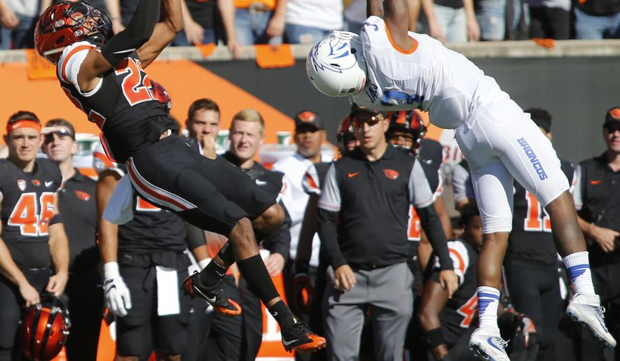 FILE - In this Sept. 24, 2016, file photo, Oregon State's Seth Collins, left, gets behind Boise State's Brandon Arnold, right, to make a catch in the second half of an NCAA college football game in Corvallis, Ore. The change in positions for Oregon State quarterback Set Collins seemed inevitable at the end of last season, when he was used in several roles in the finale against Oregon. Now Collins has embraced his new role as receiver, joining a handful of prospective QBs across the league who have made shifted positions. (AP Photo/Timothy J. Gonzalez, File)