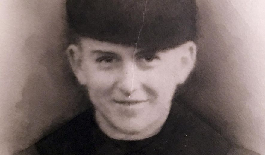 This undated photo provided by the family of Navy Fireman 3rd Class Edwin Hopkins of Keene, N.H., shows Hopkins in his uniform. Hopkins was one of the men who died when the USS Oklahoma was sunk in Pearl Harbor, Hawaii in Dec. 7, 1941. His remains have recently been positively identified and will be returned to New Hampshire to be buried next to his parents in his hometown. (Courtesy of the family of Navy Fireman 3rd Class Edwin Hopkins via AP)