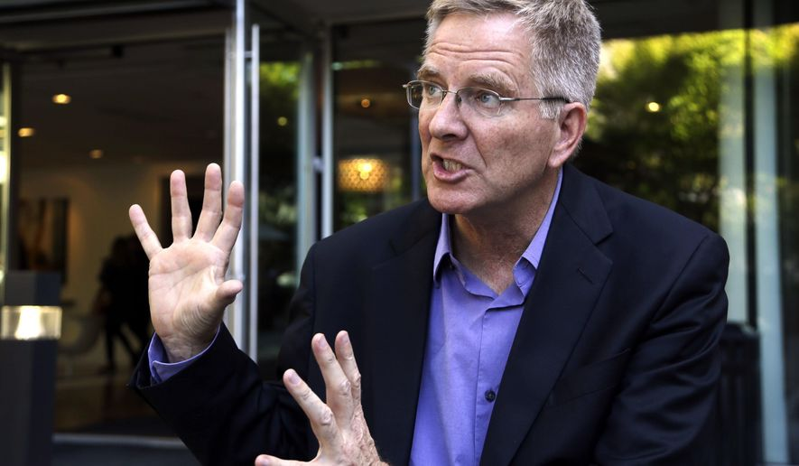 """FILE - In this Tuesday, Oct. 7, 2014, file photo, Rick Steves speaks during an interview in Portland, Ore. Steves said the U.S. can learn from Europe when comes to easing restrictions on marijuana. The host of the PBS series """"Rick Steves' Europe"""" was in Amherst on Tuesday, Oct. 11, 2016, to open a statewide tour in support of a ballot question that would legalize recreational marijuana use in Massachusetts. (AP Photo/Don Ryan, File)"""