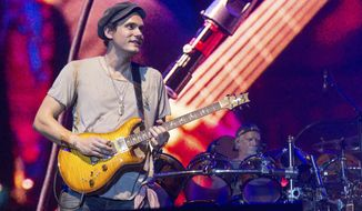 "FILE - In this June 12, 2016 file photo, John Mayer of Dead & Company performs at Bonnaroo Music and Arts Festival in Manchester, Tenn. Mayer won't be performing at a tribute concert honoring the late rock icon Prince on Thursday. Concert promoter Randy Levy told the Minneapolis Star Tribune late Tuesday, Oct. 11, that Mayer had a ""change of schedule"" and had to withdraw from the concert at the Xcel Energy Center in St. Paul, Minnesota. (Photo by Amy Harris/Invision/AP, File)"