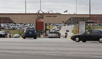Vehicles drive in and out of Lancer Gate at Tinker Air Force Base in Oklahoma City, Wednesday, Oct. 12, 2016. (AP Photo/Sue Ogrocki) ** FILE **