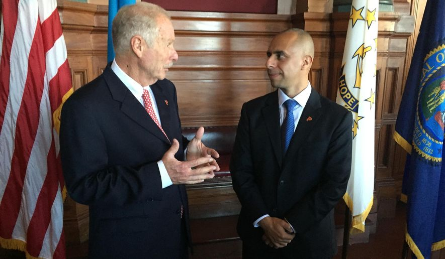 Guatemala City Mayor Alvaro Arzu, left, and Providence Mayor Jorge Elorza talk after signing a sister city agreement on Wednesday, Oct. 12, 2016, at Providence City Hall in Providence, RI. Arzu was Guatemala's president from 1996 through 2000. (AP Photo/Matt O'Brien)