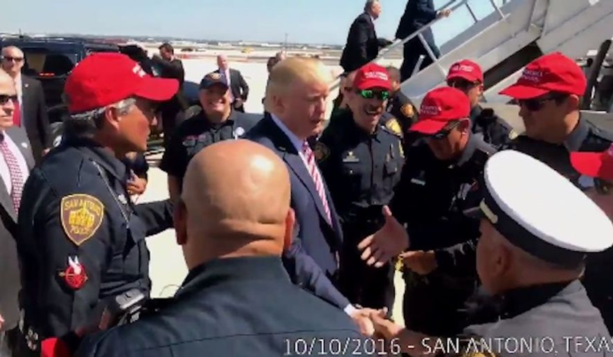 "More than a dozen San Antonio Police Department officers will face disciplinary action after they donned ""Make America Great Again"" campaign hats in a video tweeted by Republican presidential nominee Donald Trump. (Twitter/@realDonaldTrump)"