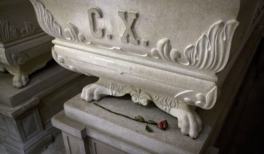 This photo from Friday, Oct. 7, 2016, shows sarcophagus of king Charles X and a rose, inside the crypt of the Kostanjevica monastery in Nova Gorica, Slovenia. The only French king buried outside France, Charles X was laid to rest in Nova Gorica nearly 200 years ago, after fleeing a French revolution. Recently, a group of historians and royalists in France have been campaigning to have the king's remains reburied back home. (AP Photo/Darko Bandic)