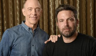 "In this Sept. 30, 2016 photo, J. K. Simmons, left, and Ben Affleck pose at The Four Seasons Hotel in Los Angeles to promote their film, ""The Accountant."" (Photo by Chris Pizzello/Invision/AP)"