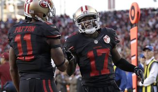FILE - In this Oct. 6, 2016, file photo, San Francisco 49ers wide receiver Jeremy Kerley (17) is congratulated by Quinton Patton (11) after scoring on a reception during the first half of an NFL football game against the Arizona Cardinals, in Santa Clara, Calif. Despite not joining San Francisco until two weeks before the opener, Jeremy Kerley has quickly developed into the 49ers top receiver. (AP Photo/Marcio Jose Sanchez, File)