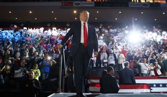 Republican presidential candidate Donald Trump arrives to speak at a campaign rally, Thursday, Oct. 13, 2016, in Cincinnati, Ohio. (AP Photo/ Evan Vucci)