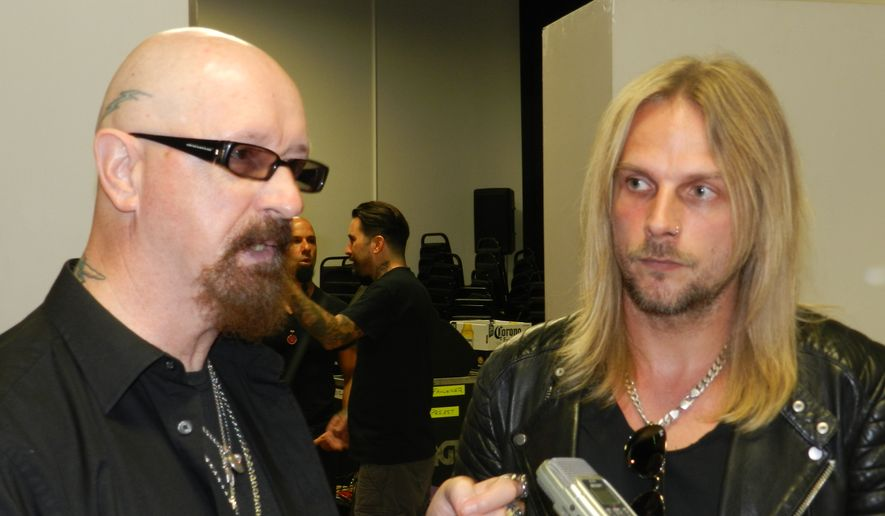 Judas Priest lead singer Rob Halford (left) and guitarist Richie Faulkner.  (Dave Kapp)