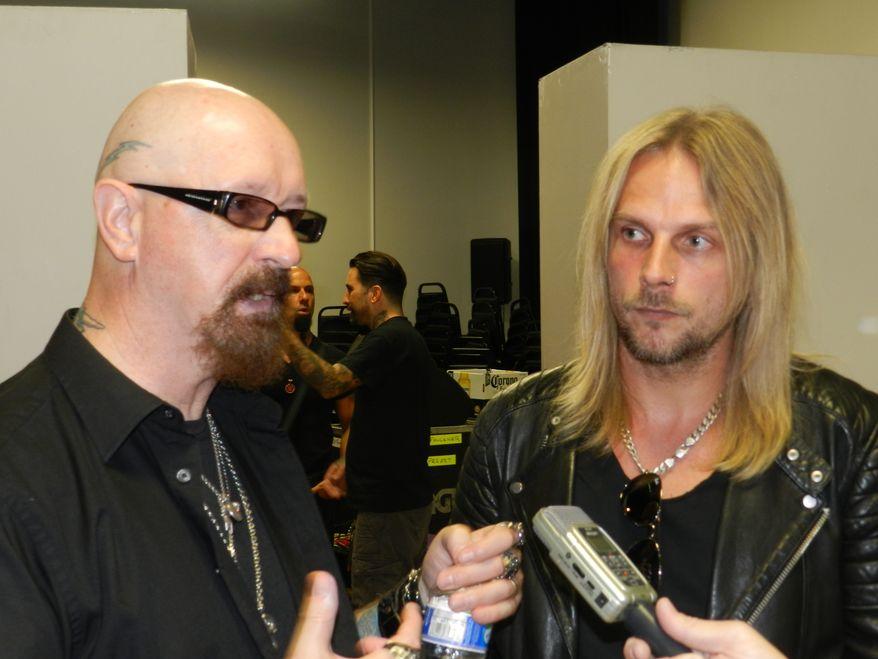 Judas Priest lead singer Rob Halford (left) and guitarist Richie Faulkner.  (Dave Kapp)